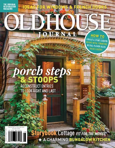 Old House Journal cover shot of front entrance with an archway and plants.