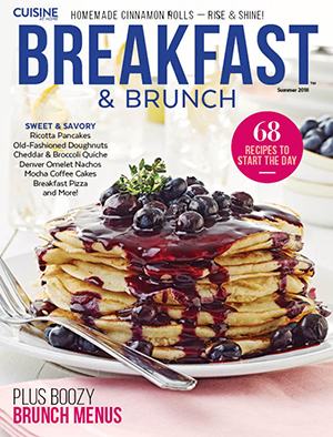 Cuisine Breakfast & Brunch magazine cover shot of stack of pancakes with blueberry sauce.