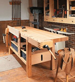 Woodshop table with various woodworking tools.